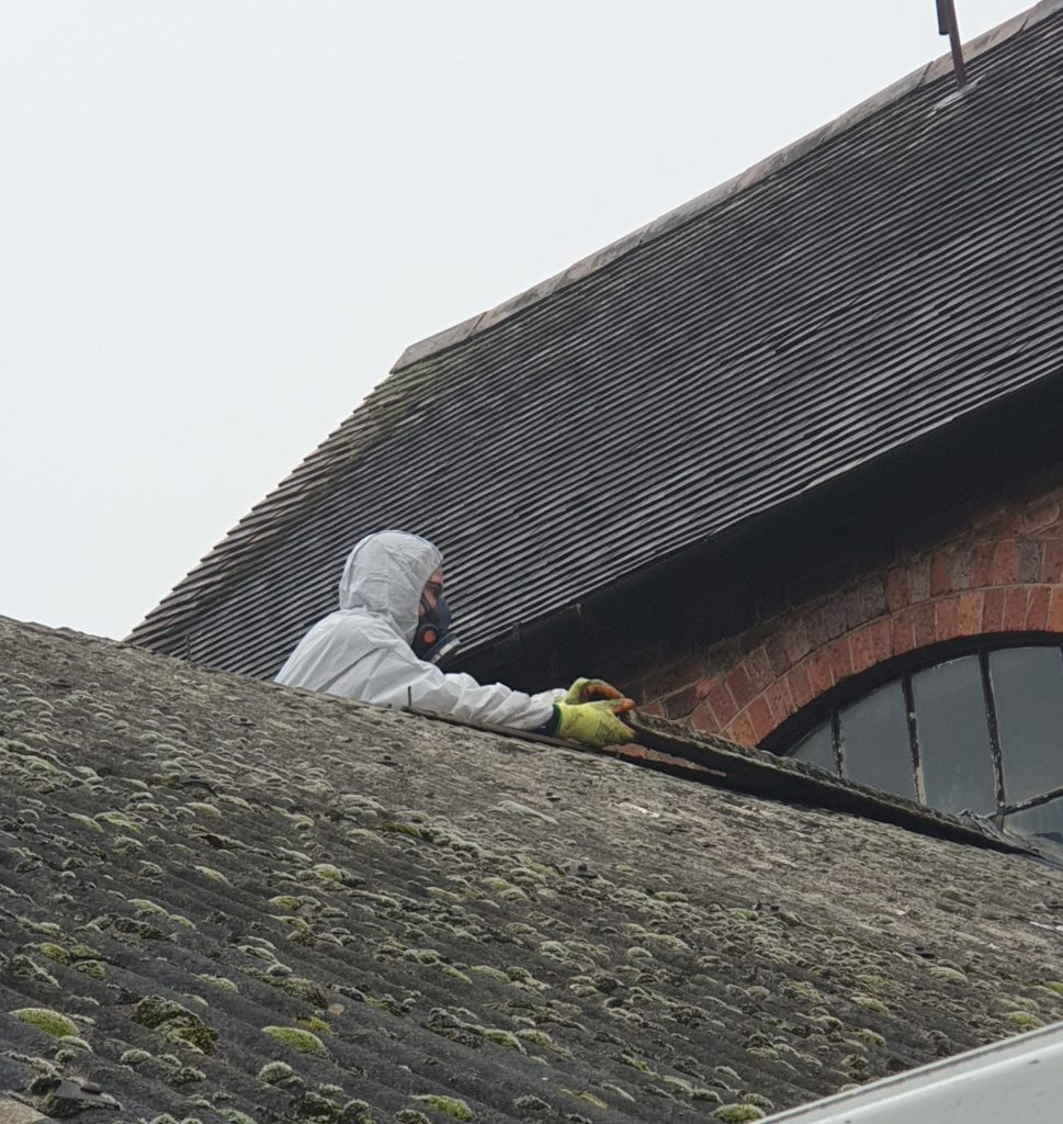 asbestos removal being carried out on a roof in london